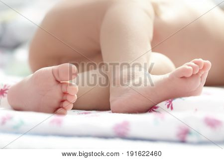 Close-up photo of the newborn legs. Horizontal photo