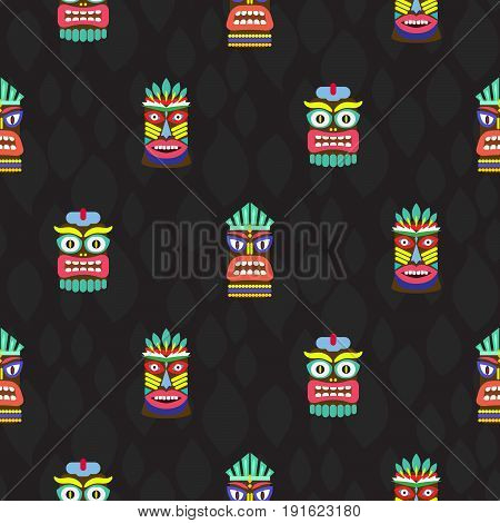 Colorful tiki masks totems seamless dark pattern vector. Hawaiian culture bright background.