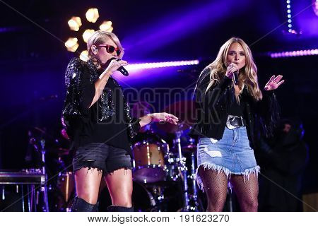 NASHVILLE, TN - JUNE 08: Miranda Lambert (R) and Gwen Sebastian perform at Nissan Stadium during the 2017 CMA Festival on June 8, 2017 in Nashville, Tennessee.
