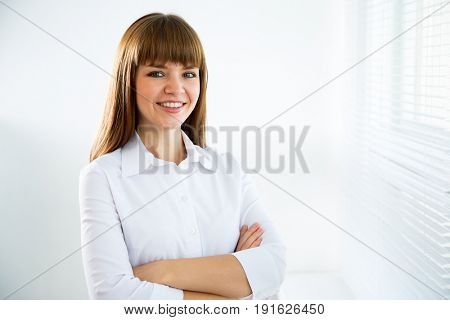 Portrait of a business woman against a window.