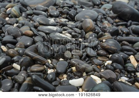 Black stones beach as a background. Black stones using as a background.