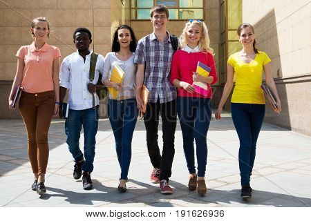 Group of diverse students outside walking together