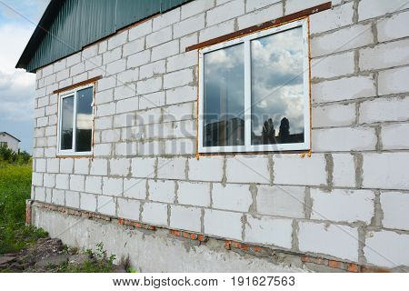 KIEV - UKRAINE JUNE - 20  2017: Window installation and Replacement Details with Facade Outdoor. Window Construction with Insulation. Foundation wall ready for stucco plastering and insulation.