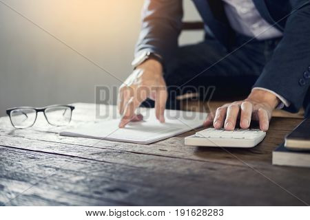 Business Man Holding A Blank Notebook And Calculate Business Profits Turnover Business With Calculat