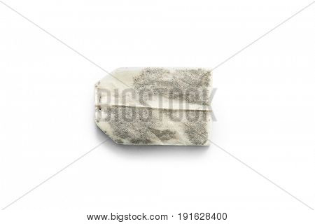 Lonely teabag with black, green or herbal tea, ready to be brewed, topview