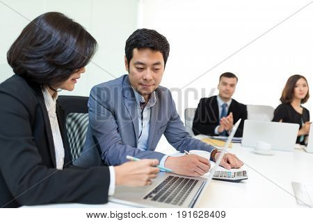 Business discussion in office