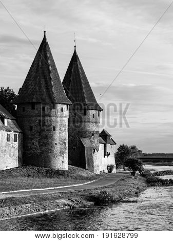 Two fortification towers at Nogat River in Malbork, Pomerania, Poland. Black and white image.