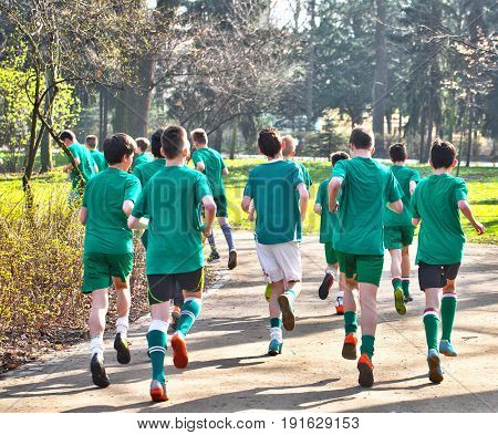 Boys from the football youth club exercising in the public park in Poland