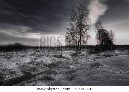 Sunset above winter field. Photographed in Russia in the 60 km from Moscow poster