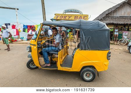 Hell-Ville Madagascar - December 19 2015: Traditional rickshaw customers waiting at the Hell-Ville Nosy Be Island Madagascar.
