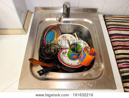 Dirty Dishes In The Sink, In The Kitchen
