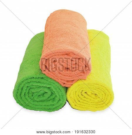 Yellow, Green And Red Rolled Up  Towels Isolated