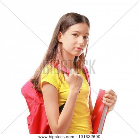 Cute pretty girl with schoolbag and book on white background