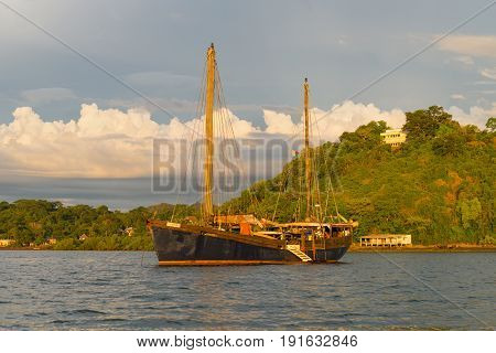 Hell-Ville Madagascar - December 19 2015: SV Ooskus vessel in the rays of the setting sun anchored at Andavakotakona Bay near Hell-Ville Nosy Be Island Madagascar.