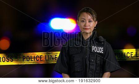 Asian American Policewoman Smiling At Camera