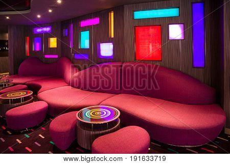 Cruise liner Splendida - May 30, 2017: Red sofa in bar modern interior on cruise liner Splendida.