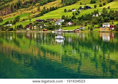 Norway, Olden village, green hills seaside landscape.