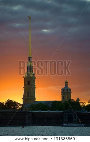 Peter and Paul Cathedral in the background of a gloomy sunset. Evening St. Petersburg