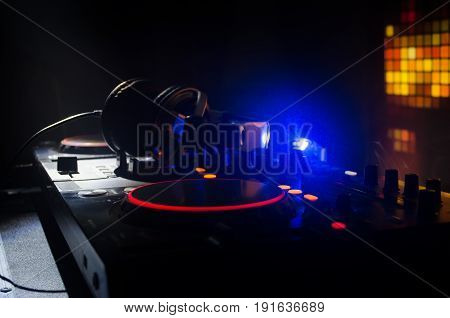 Dj Spinning, Mixing, And Scratching In A Night Club, Hands Of Dj Tweak Various Track Controls On Dj'