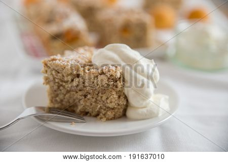 Home made apricot cake with streusel on a plate