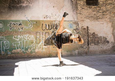 Contempo Dancer Doing A Leg Split