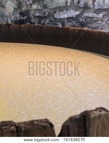 Bourbon Mash Fermenting in Distillery in open tank