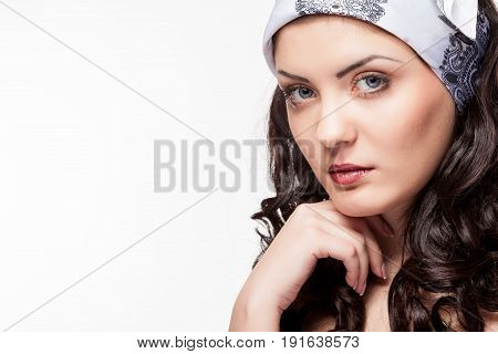 Portrait of beautiful woman on white background in studio photo. Beauty and fashion. Close up portrait