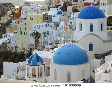 Greek Islands traditional white and blue churches and architecture at Oia village, Santorini island of Greece