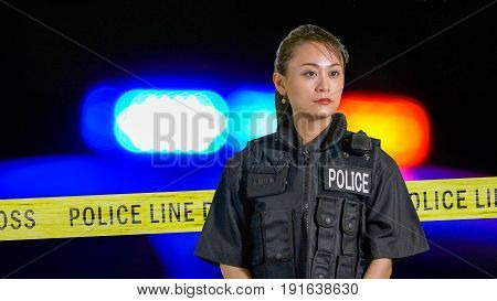 Asian American Policewoman Using Police Radio