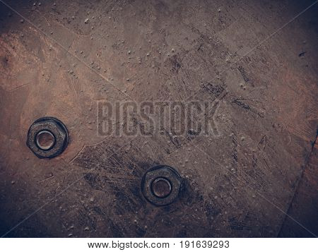 Construction machines concept. Detailed closeup of screws and bolts on black indrustrial machinery