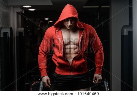 Strong Athletic Man Fitness Model In A Hood Torso Showing Six Pack Abs