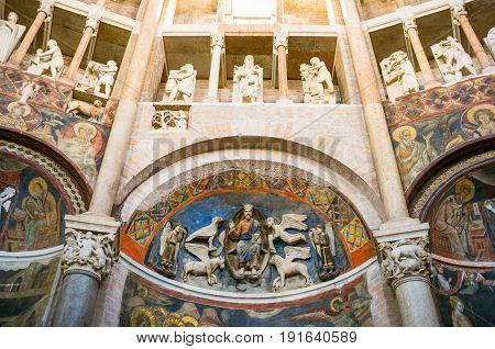 Parma, Italy - November 28, 2013: Frescoes, paintings and sculptures in the baptistery of the basilica cathedral