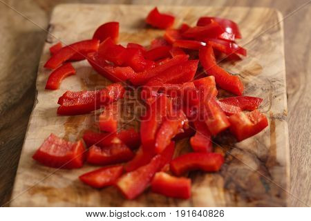 chopped red bell pepper on cutting board, shallow focus