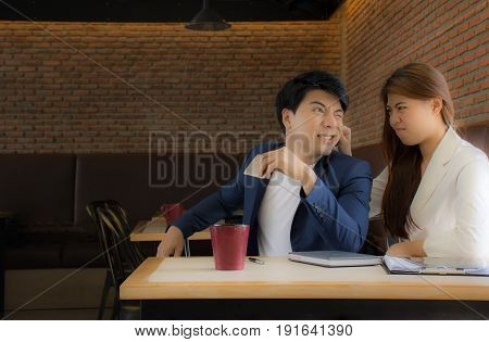 Woman angry at her boyfriend while men are talking on the phone.