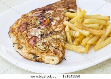 Omelette, Decorated With Chips, On White Background