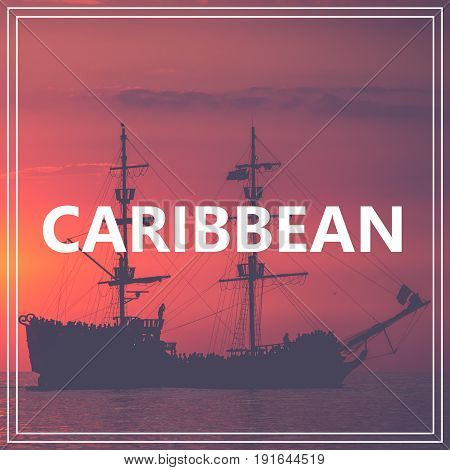 Your Course To Caribbean. Pirate Boat On The Sea At Sunset. Red Sky.