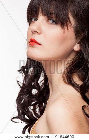 Gorgeous girl in sensual portrait. Studio photo. Attractive model on white background