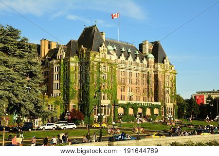 Victoria BC,Canada,July 16th 2015.The iconic Empress hotel in Victoria is a true Victorian landmark.Right across Victoria's famous inner harbor and close to downtown and other interesting attractions.Come to Vancouver island and visit Victoria.