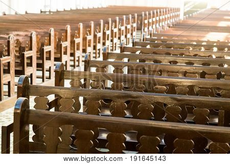 Rows Of Empty Pew Benches Inside Chapel Church