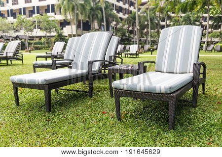 Relaxing Deck Chairs At Tropical Resort With Nobody