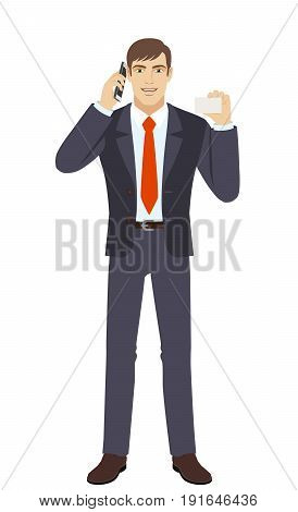 Businessman talking on the mobile phone and showing the business card. Full length portrait of businessman character in a flat style. Vector illustration.