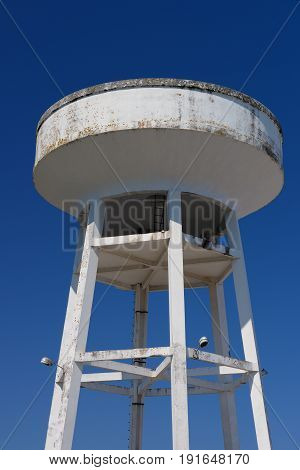 image of water tower against the blue sky