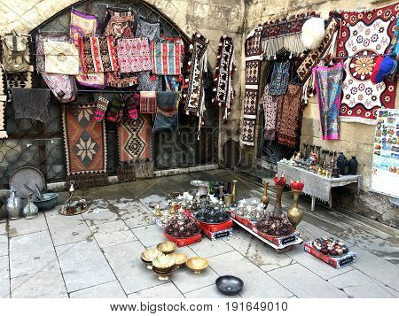 National souvenirs. Carpets. Dishes. Dolls.souvenir shop, carpet