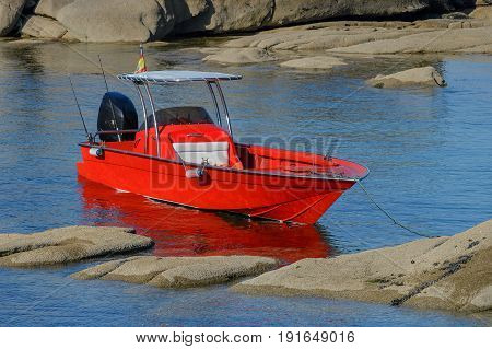 red boat moored in the sea lagoon