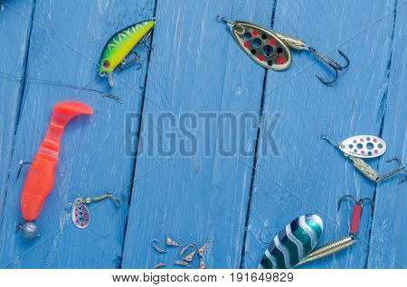Fishing Lures Are Arranged In A Circle Shape. Space For The Inscription. Copyspace.