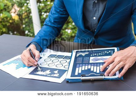 Business Statistics Success Concept : Businessman Analytics Financial Accounting Market Chart