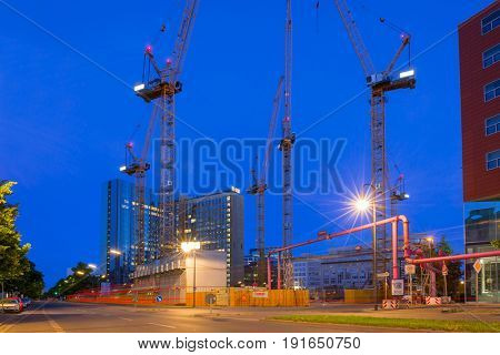 BERLIN, GERMANY - JUNE 15, 2017: Building constructions in Berlin at night, Germany. Berlin is the capital and the largest city of Germany with a population of approximately 3.7 million people.