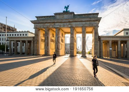 BERLIN, GERMANY - JUNE 15, 2017: The Brandenburg Gate in Berlin at sunrise, Germany. Brandenburg Gate is an 18th-century neoclassical monument and one of the best known landmarks of Germany.