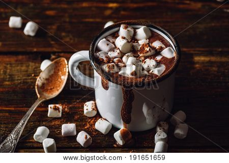 Cocoa Mug with Marshmallow. Some Marshmallow and Cocoa Powder Scattered on Wooden Table.