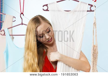 Happy Smiling Woman Next To Short White Dress
